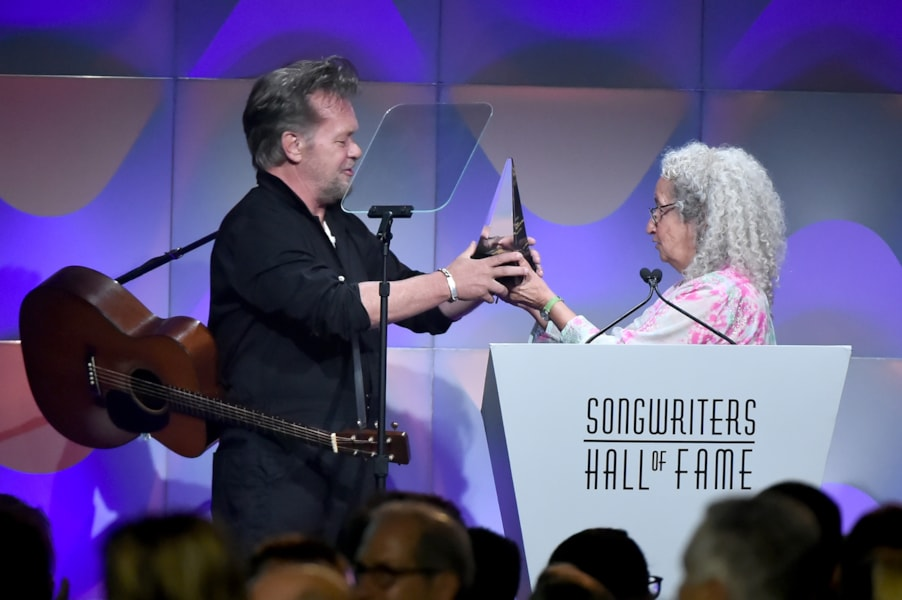 NEW YORK, NY - JUNE 14:  Songwriters Hall of Fame Inductee John Mellencamp accepts award from Nora Guthrie onstage during the Songwriters Hall of Fame 49th Annual Induction and Awards Dinner at New York Marriott Marquis Hotel on June 14, 2018 in New York City.  (Photo by Theo Wargo/Getty Images for Songwriters Hall Of Fame ) *** Local Caption *** John Mellencamp;Nora Guthrie