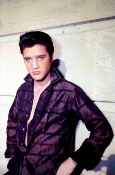 Singer Elvis Presley poses for a studio portrait. (Photo by Liaison)
